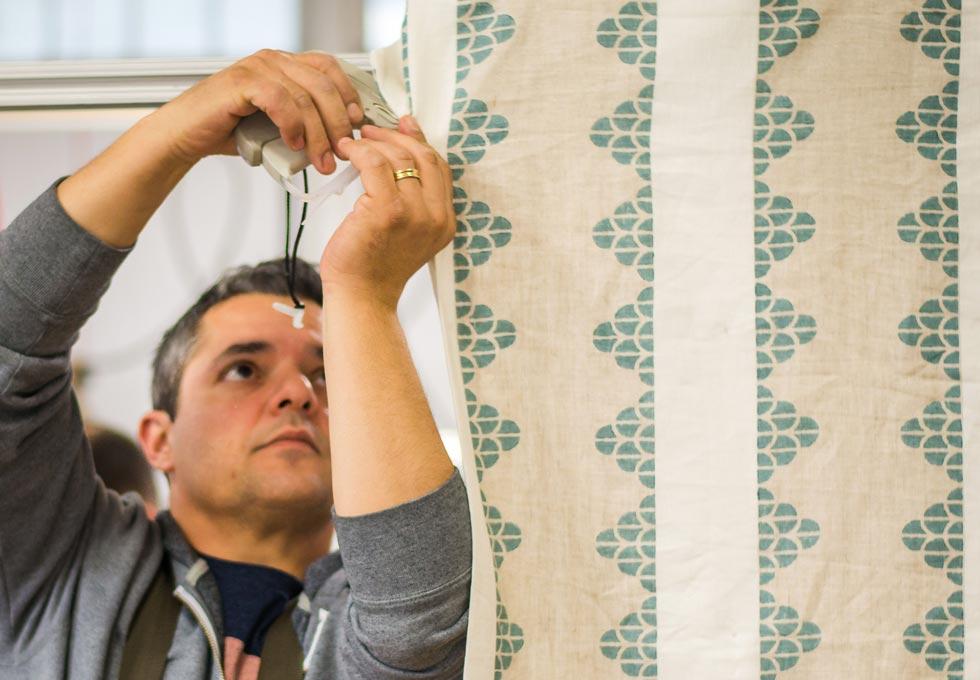 Makkas worker stitching fabric